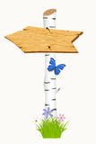 Wooden arrow with flowers and butterflies. Stock Photos