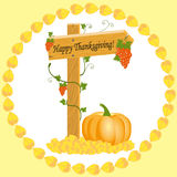 Wooden arrow with grapes and pumpkins Thanksgiving Stock Photo