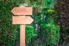 Wooden arrow point opposite directions Stock Image