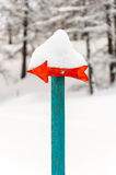 Wooden arrow signal with snow Royalty Free Stock Photography