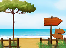 Wooden arrow signboards at the beach Stock Images