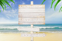 Wooden arrow signs on beach background Royalty Free Stock Photos