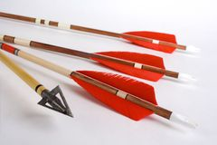 Wooden arrows. Photo from wooden fletched bow arrows and hunting point (broadhead Royalty Free Stock Photo