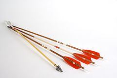 Wooden arrows. Photo from wooden fletched bow arrows and hunting point in one arrow. (broadhead Royalty Free Stock Image