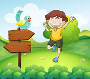 The wooden arrows with a bird beside a young man Stock Photography