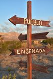 Wooden arrows handpainted signs with names of towns in Mexico Stock Photos