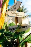 Wooden arrows signboards on the beach resort. Spider House. Wahine beach bar stock images