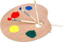 Wooden art palette with blobs of paint and a. Art wooden palette blobs color white background royalty free stock images