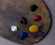 Wooden art palette with colors up close Stock Image