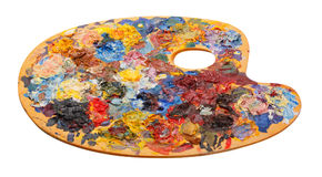 Wooden art palette with oil paints and a brushes isolated on whi Stock Photo