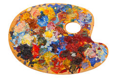 Wooden art palette with oil paints and a brushes isolated on whi Royalty Free Stock Photography