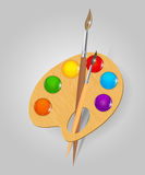 Wooden art palette with paints and brushe Royalty Free Stock Image
