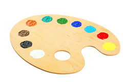 Wooden art palette with paints isolated on a white stock photography