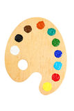 Wooden art palette with paints isolated on a white Stock Photos