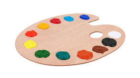 Wooden art palette with paints Royalty Free Stock Images