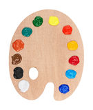 Wooden art palette with paints Royalty Free Stock Image