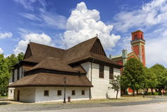 Wooden articular church in Kezmarok and lutheran tower, Slovakia Stock Photos