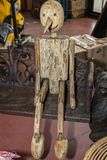 Wooden Articulated Puppet Sitting on a Bench royalty free stock photo