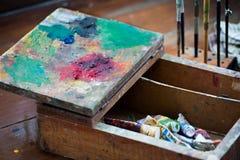 Wooden artist box pallete Stock Photo