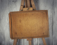 Wooden artist easel. With an old plywood sub-frame stock photo