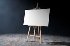 Wooden Artist Easel with White Mock Up Canvas and Palette. 3d Re. Wooden Artist Easel with White Mock Up Canvas and Palette on a white background. 3d Rendering Stock Images