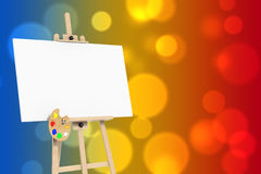 Wooden Artist Easel with White Mock Up Canvas and Palette. 3d Re Royalty Free Stock Photo