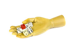 Wooden artist manikin hand with colorful bones dice. Of game,isolated on white royalty free stock images