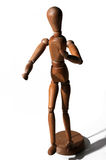 Wooden artists Mannequin. On a white background royalty free stock photo
