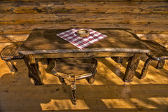 Wooden ashtray on a wooden table. On the cottages from logs balcony Stock Photo