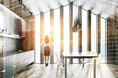 Wooden attic kitchen with table, woman royalty free stock photos