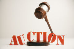 Wooden auction gavel. In mid air on light background. 3D Rendering Stock Photos