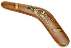 Wooden Australian Boomerang. A Wooden Australian Boomerang pattern decorated with Kangaroo Royalty Free Stock Photos