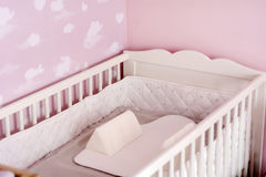 Wooden baby bed Stock Image