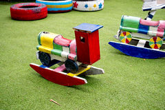 Wooden baby car on two springs on kids playground Stock Photos
