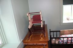 Wooden baby furniture and cradle inside Amish house. This Amish village is located in Lancaster County, Pennsylvania Stock Photo