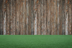 Wooden backgound, green grass Stock Photos