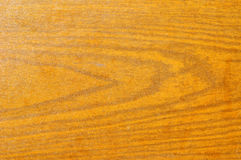 Wooden background. Wood grain texture which can be tiled in a seamless pattern Royalty Free Stock Photo