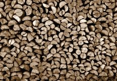Wooden background. Texture of small stacked firewood Stock Images