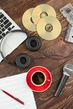 Wooden background with audio devices. royalty free stock photo