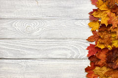 Wooden background with autumn leaves Royalty Free Stock Photo