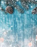 Wooden background of azure, marine. Green fir tree. Decorative cones. Space for Xmas and New Year Message. Royalty Free Stock Images