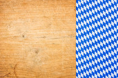 Wooden background with a bavarian tablecloth Stock Image