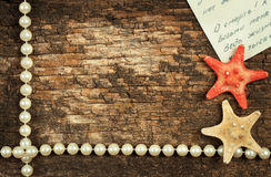 Wooden background with beads Royalty Free Stock Photography