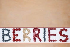 Wooden background with berries text Stock Photography