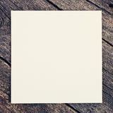 Wooden background with blank paper Royalty Free Stock Photos
