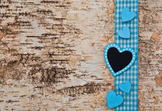 Wooden background with blue heart Royalty Free Stock Image