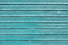 Wooden background from blue vintage board with peeling paint Stock Image