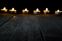 Wooden background with bokeh with candles Royalty Free Stock Images