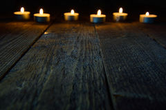 Wooden background with bokeh with candles.  Royalty Free Stock Photos