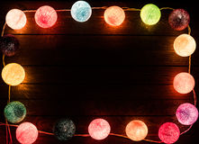 Wooden background with border from christmas. Lights, dark middle for text royalty free stock images